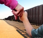 Should it be a crime for parents to cross the border w/ children?