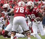 Which needs to improve most for the Huskers - running or passing?