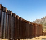 Should defense money be used to continue funding the wall?