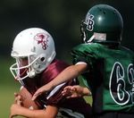 Is it OK for grade-school kids to play tackle football?