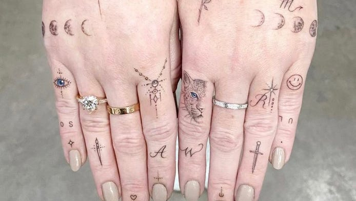 Thumbs up or thumbs down on hand tattoos?