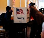 Should a driver's license or another photo ID be required to vote?
