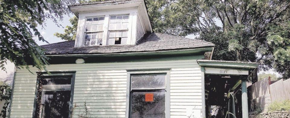 Should deteriorating-but-historic buildings be demolished or restored?