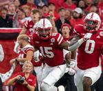 Will the Huskers have more yards rushing or passing this weekend against Michigan?